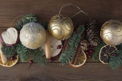 Christmas fir tree with decoration on dark wooden board background. Border with Christmas tree, baubles. Copy space. Christmas fir tree with decoration on dark stock photo