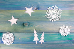 Christmas fir tree with decoration on dark wooden board. Snowfla Stock Photography