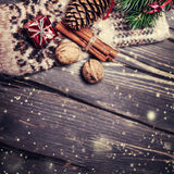 Christmas fir tree with decoration on dark wooden board in vinta Stock Image