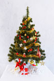 Christmas fir tree with decoration and presents Stock Photos