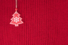 Christmas fir tree decoration on red wool knitted fabric Royalty Free Stock Photography