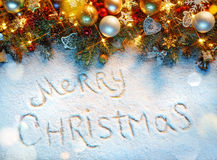 Christmas fir tree with decoration on snowy background. Royalty Free Stock Photo