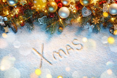 Christmas fir tree with decoration on snowy background. Royalty Free Stock Photography