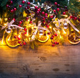 Christmas fir tree with decoration on wooden background Royalty Free Stock Image