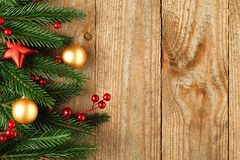 Christmas fir tree with decoration on a wooden Stock Photography