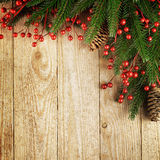 Christmas fir tree with decoration on a wooden board Stock Image