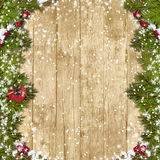 Christmas fir tree with decoration on a wooden board. Christmas  wooden background  with  beautiful Christmas garland and snow Stock Images