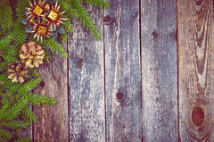 Christmas fir tree with decoration on a wooden board Royalty Free Stock Images