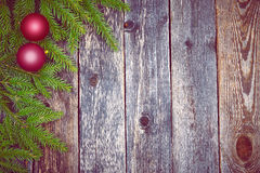 Christmas fir tree with decoration on a wooden board Royalty Free Stock Photo