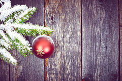 Christmas fir tree with decoration on a wooden board Stock Images