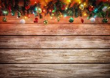 Christmas fir tree garland with decoration on wooden board. Bright Christmas and New Year background with empty space stock images