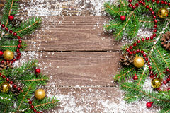 Christmas fir tree with decoration on wooden board Stock Photography