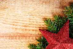 Christmas fir tree with decoration on wooden board. Vintage fram Royalty Free Stock Photo