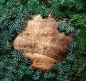 Christmas fir tree with decorations on dark wooden board, vintag. E holiday concept with copy space Stock Images