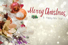 Christmas fir tree with decorations. Christmas white tree with holiday red and orange decorations and lights with copy space on silver bokeh background with Royalty Free Stock Photos