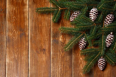 Christmas fir tree with decorations on wooden background. Royalty Free Stock Photography