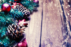 Christmas fir tree with decorations on wooden backgroundChr Royalty Free Stock Image
