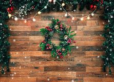 Christmas fir tree garland with christmas tree decoration on wooden board. Bright Christmas and New Year background with royalty free stock photo