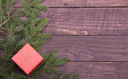 Christmas fir tree with gift boxe on wooden board Stock Images