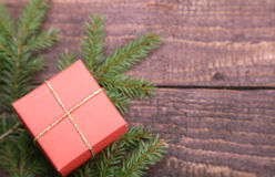 Christmas fir tree with gift boxe on wooden board Stock Photos