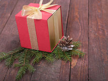 Christmas fir tree with gift boxe on wooden board Stock Photo