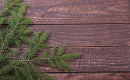 Christmas fir tree with gift boxe on wooden board Royalty Free Stock Photography