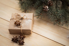 Christmas fir tree and gifts on wooden background. Star anice Stock Image