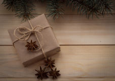 Christmas fir tree and gifts on wooden background. Star anise Stock Photo