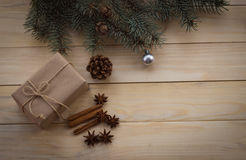 Christmas fir tree and gifts on wooden background. Star anise. Cinnamon Stock Photography