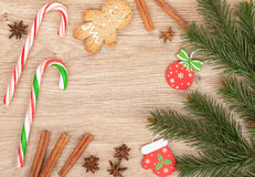 Christmas fir tree, gingerbread cookie and candy cane Royalty Free Stock Photos
