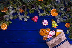 Christmas fir tree and gingerbread cookies on the blue wooden bo Stock Photo