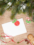 Christmas fir tree, gingerbread cookies and card for copy space Stock Photography