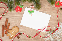Christmas fir tree, gingerbread cookies and card for copy space Royalty Free Stock Photo
