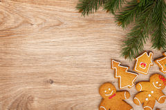 Christmas fir tree and gingerbread cookies Stock Image