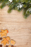 Christmas fir tree and gingerbread cookies Stock Photography