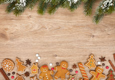 Christmas fir tree and gingerbread cookies Royalty Free Stock Image