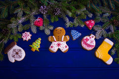 Christmas fir tree and gingerbread cookies on wooden board Royalty Free Stock Photography