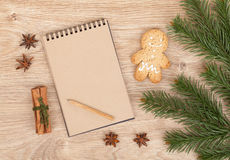 Christmas fir tree, gingerbrean man and blank notepad Royalty Free Stock Images