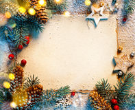 Christmas fir tree with greeting card on wooden background. royalty free stock image