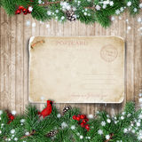 Christmas fir-tree with greeting card on wooden board Stock Photography