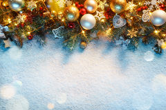Christmas fir tree with lights on snow royalty free stock images