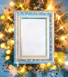 Christmas fir tree with lights and white festive frame. Stock Photos