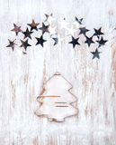 Christmas fir-tree made of birch bark with stars Stock Images