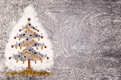 Christmas fir tree made from flour on a black background. Free space. Stock Image