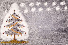 Christmas fir tree made from flour on a black background. Free space. Stock Photos
