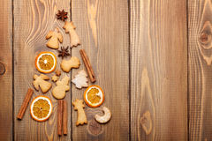 Christmas fir tree made from food decoration spices and gingerbr. Ead cookies on wooden table. View from above with copy space Royalty Free Stock Photos