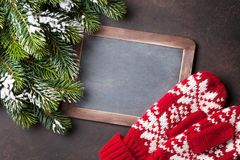 Christmas fir tree, mittens and chalkboard for your greetings Stock Images