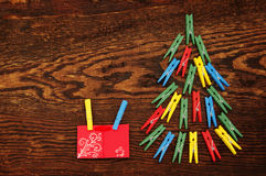 Christmas fir-tree from multi-colored clothespins on the made old wooden brown background Stock Images