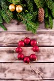 Christmas fir tree on natural wooden background with red balls. Postcard Stock Images