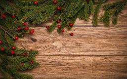 Christmas fir tree on a oak board Royalty Free Stock Image